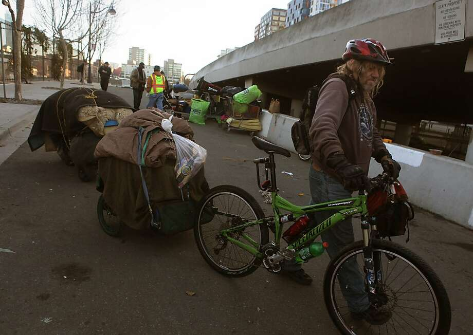 Randy Stone tows his belongings from the homeless encampment beneath the Interstate 280 on-ramp in San Francisco, Calif., on Monday, March 11, 2013.   The encampment was forced to leave this morning with a permanent fence planned to keep the camp out of the area. Photo: Liz Hafalia, The Chronicle