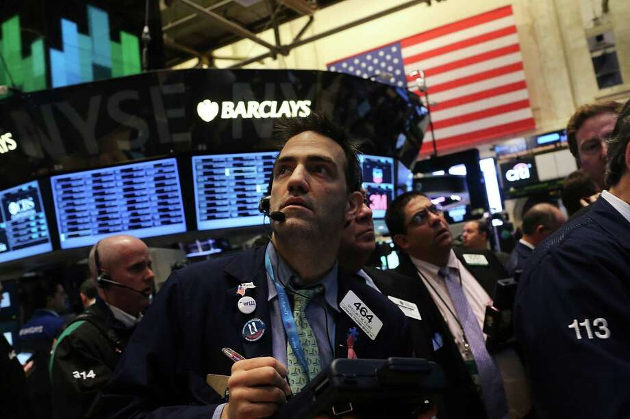 NEW YORK, NY - MARCH 06:  Traders work on the floor of The New York Stock Exchange on March 6, 2013 in New York City. One day after the Dow Jones Industrial Average rallied to a record high to close at 14,253.77, stocks were up over 40 points in morning trading.  (Photo by Spencer Platt/Getty Images) Photo: Spencer Platt / 2013 Getty Images