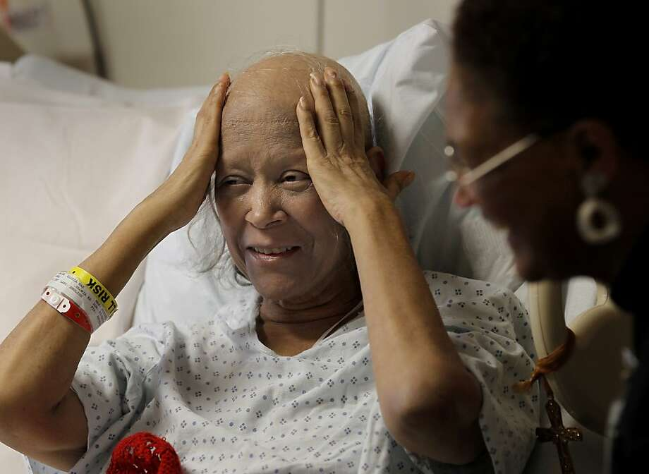 Cancer patient Gloria Romaine talks with the Rev. Betty Clark at Alameda County Medical Center. Photo: Brant Ward, The Chronicle