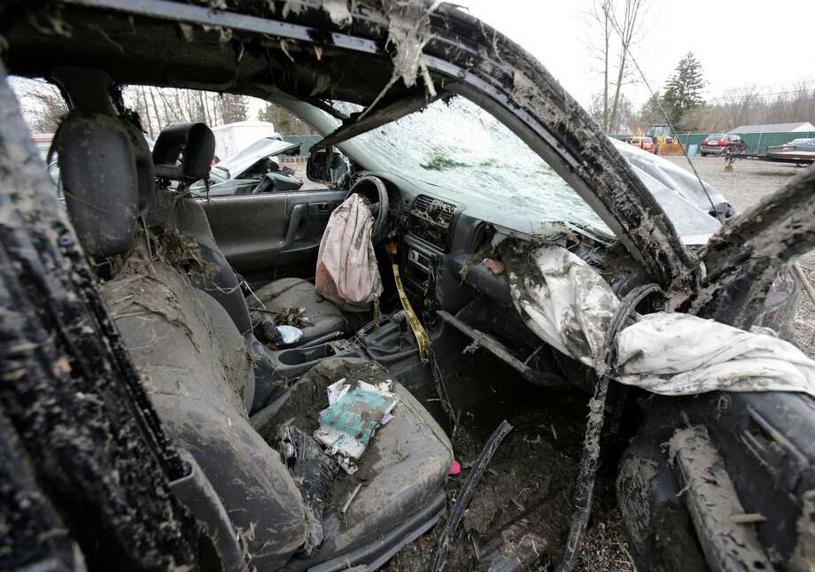 This Monday, March 11, 2013 photo in Southington, Ohio shows the interior of a vehicle where six people died in a crash early Sunday in Warren, Ohio. Two teens who escaped the crash that killed six friends in a swampy pond wriggled out of the wreckage by smashing a rear window and swimming away from the SUV, a state trooper said Monday. (AP Photo/Tony Dejak) Photo: Tony Dejak