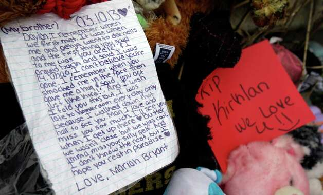 A note rests on a memorial where six teens died early Sunday in Warren, Ohio, on Monday, March 11, 2013. Two teens who escaped a crash that killed six friends in a swampy pond wriggled out of the wreckage by smashing a rear window and swimming away from the SUV, a state trooper said Monday. (AP Photo/Tony Dejak) Photo: Tony Dejak