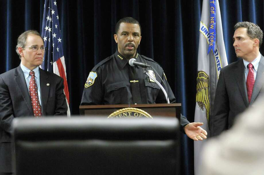 Bob Carney, left, Schenectady County D.A., Schenectady Police Chief Mark Chaires, center, and United States Attorney Richard Hartunian take part in a press conference on Tuesday, April 3, 2012 in Albany, NY to discuss the Schenectady-focused gang raid that took place earlier in the day.   (Paul Buckowski / Times Union) Photo: Paul Buckowski / 00017080A