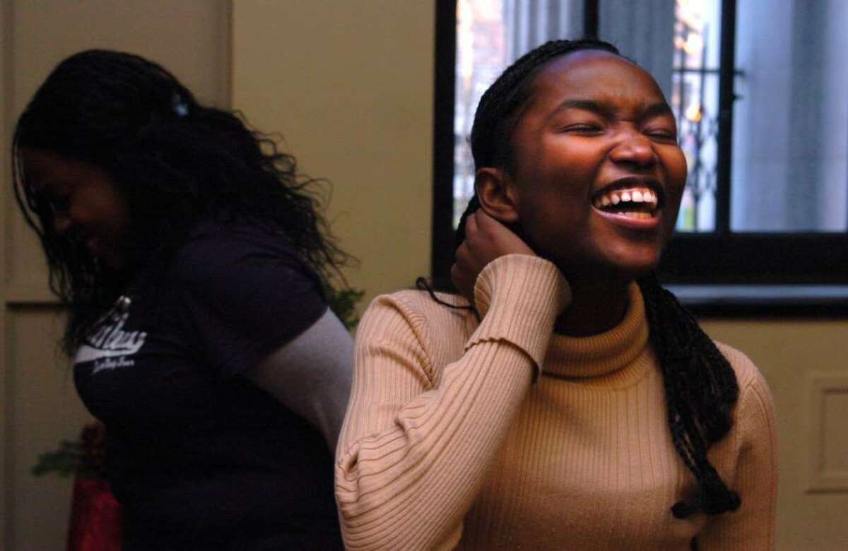 Kathleen Larose, 15, laughs during a warm-up exercise with the Harding Drama Club, including Denepha Edmondson left, Thursday prior to recording the group's Public Service Announcement about teen dating violence at Playhouse on the Green. The PSA is part of the initiative Start Strong: Building Healthy Teen Relationships, a national program of the Robert Wood Johnson Foundation in collaboration with the Family Violence Prevention Fund and it will be published on RYASAP's Youtube page.