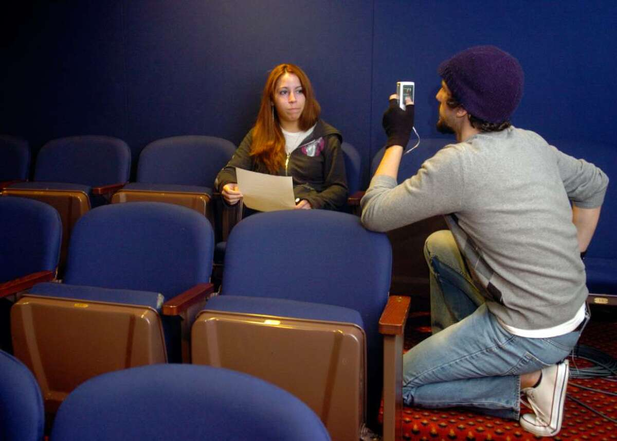 Christian Shaboo, RYASAP Media Specialist, films fifteen-year-old Marangely Davila, a member of the Harding Drama Club, for a Public Service Announcement on teen dating violence Thursday at Playhouse on the Green to be published on RYASAP's Youtube page. The PSA is part of the initiative Start Strong: Building Healthy Teen Relationships, a national program of the Robert Wood Johnson Foundation in collaboration with the Family Violence Prevention Fund.