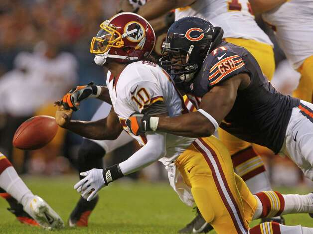 Chicago Bears defensive end Israel Idonije (71) sacks Washington Redskins quarterback Robert Griffin III (10) and forces a fumble that Julius Peppers recovered in the first quarter of a preseason game at Soldier Field in Chicago, Illinois, Saturday, August 18, 2012. (Brian Cassella/Chicago Tribune/MCT) Photo: Brian Cassella, McClatchy-Tribune News Service / Chicago Tribune