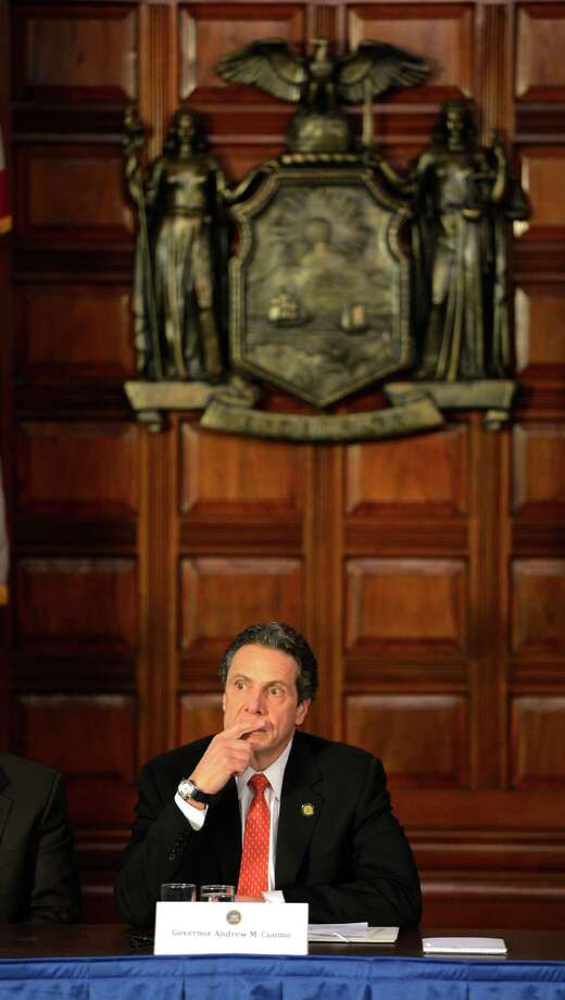 Governor Andrew Cuomo held a cabinet meeting today March 11, 2013, in the Red Room of the State Capitol in Albany, N.Y.  Various subjects were covered including a new state data base and the announcement of the start-up of the new Office for New Americans.   (Skip Dickstein/Times Union) Photo: SKIP DICKSTEIN / 10021504A