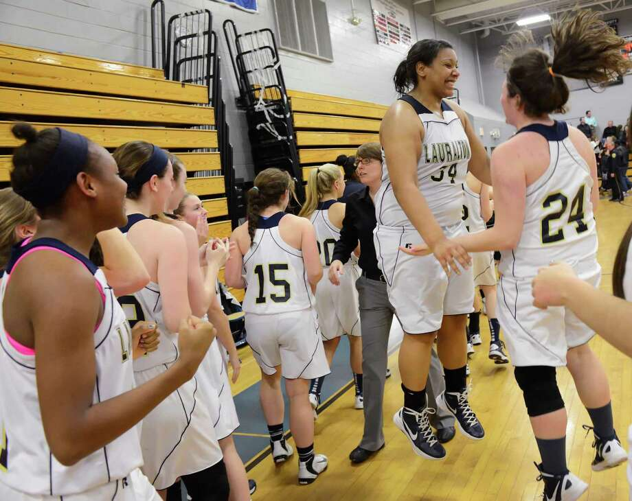 The Lauralton Hall school girls basketball team celebrates their win against Trumbull high school in a CIAC class LL girls basketball semifinal game held at Fairfield Ludlowe high school, Fairfield, CT on Monday March 11th, 2013 Photo: Mark Conrad / Connecticut Post Freelance