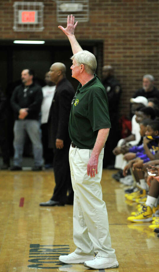 Trinity Catholic head coach Mike Walsh gives directions to his team during their Class L state quarterfinal game against Career Magnet at Trinity Catholic High School in Stamford on Monday, March 11, 2013. Trinity Catholic won, 58-45. Photo: Jason Rearick / The Advocate