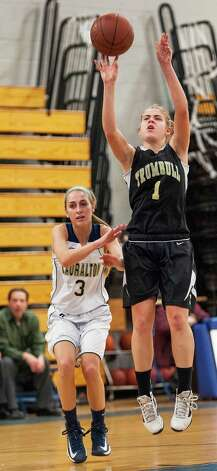Trumbull high school's Alexa Pfohl gets a shot off in a CIAC class LL girls basketball semifinal game against Lauralton Hall school held at Fairfield Ludlowe high school, Fairfield, CT on Monday March 11th, 2013 Photo: Mark Conrad / Connecticut Post Freelance