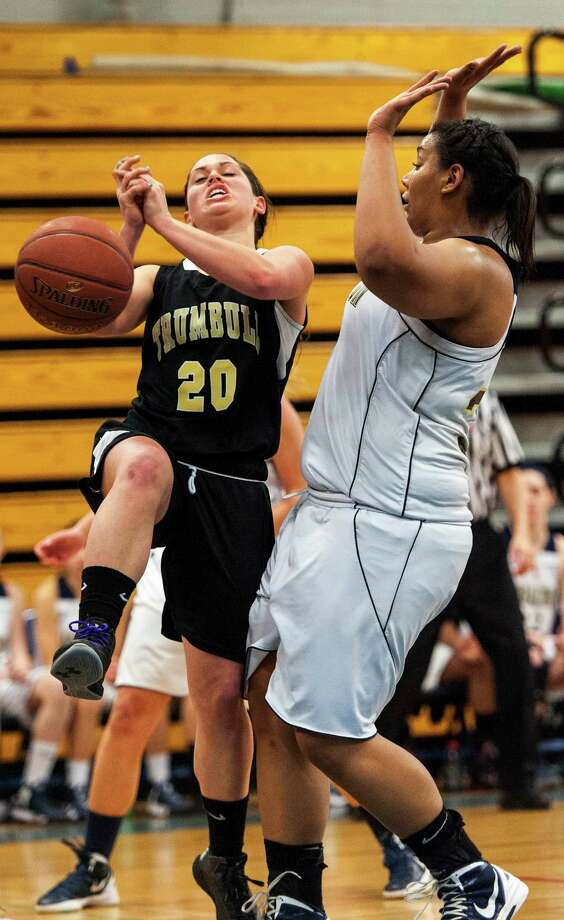 Trumbull high school's Lauren Hyde loses control of the ball as she goes up for a shot in a CIAC class LL girls basketball semifinal game against Lauralton Hall held at Fairfield Ludlowe high school, Fairfield, CT on Monday March 11th, 2013 Photo: Mark Conrad / Connecticut Post Freelance