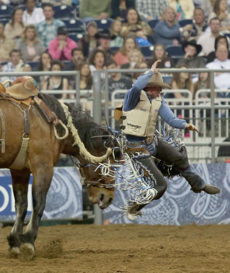 3/11/13:  Alex Wright is thrown from his saddle bronc in the Houston BP Super Series V Round 2 Houston Rodeo at  Reliant Stadium in Houston, Texas. Photo: Thomas B. Shea, For The Chronicle / © 2013 Thomas B. Shea