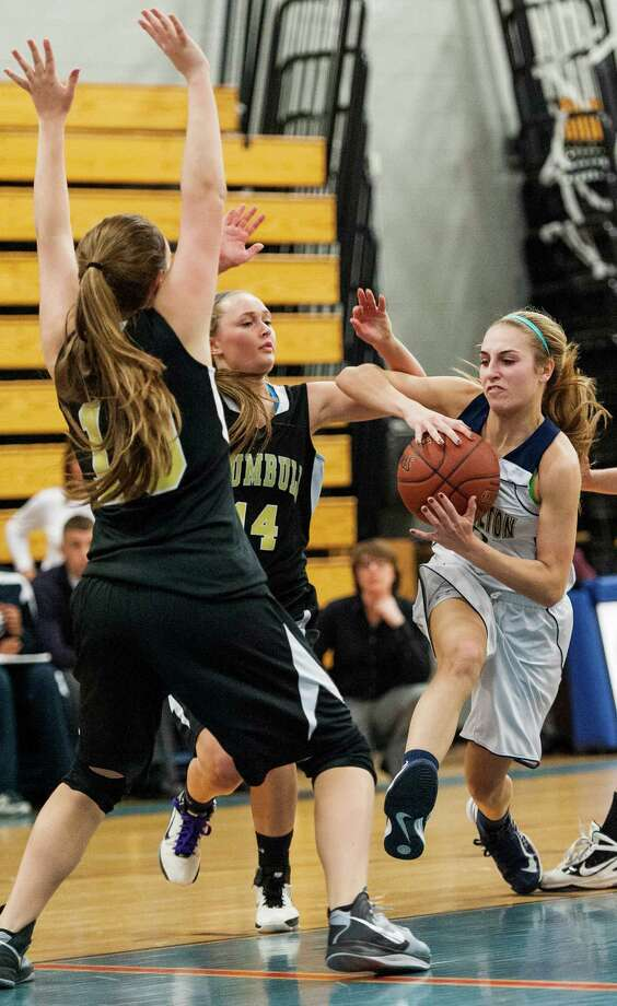 Trumbull high school's Katherine O'Leary and Danielle McGillicuddy stop Lauralton Hall's Maggie Salandra from driving toward the basket in a CIAC class LL girls basketball semifinal game held at Fairfield Ludlowe high school, Fairfield, CT on Monday March 11th, 2013 Photo: Mark Conrad / Connecticut Post Freelance