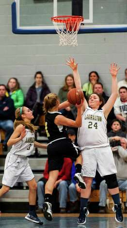 Emily Bonzagni, Lauralton Hall school, tries to stop Trumbull high school's Alexa Pfohl from getting a shot off in a CIAC class LL girls basketball semifinal game held at Fairfield Ludlowe high school, Fairfield, CT on Monday March 11th, 2013 Photo: Mark Conrad / Connecticut Post Freelance