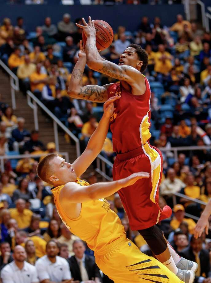 Who's hot - Iowa State's perimeter game: The Cyclones blistered West Virginia for 14 3-pointers and a season-best 60.9 percent shooting from beyond the arc. ISU has made 10 or more 3-pointers 19 times this season. Photo: David Smith, Associated Press / FR93543 AP