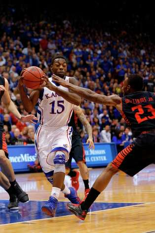 Not - Kansas G Elijah Johnson: Has hit 6 of 21 from the field  over his last two games. Photo: Orlin Wagner, Associated Press / AP