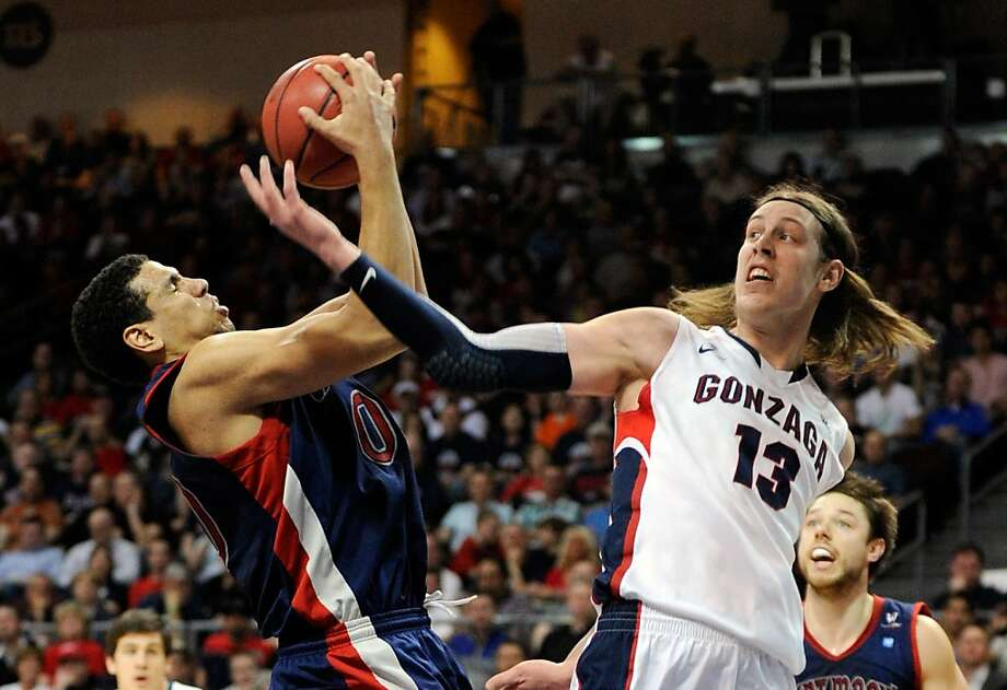 LAS VEGAS, NV - MARCH 11:  Brad Waldow #00 of the Saint Mary's Gaels and Kelly Olynyk #13 of the Gonzaga Bulldogs go for a rebound during the first half of the championship game of the West Coast Conference Basketball tournament at the Orleans Arena March 11, 2013 in Las Vegas, Nevada.  (Photo by David Becker/Getty Images) Photo: David Becker, Getty Images