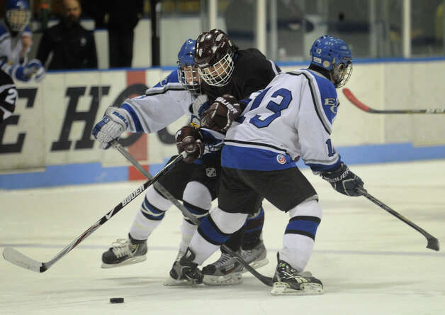 Brookfield-Bethel-Danbury's Joseph Britton is sandwiched between two East Catholic defenders during the Class 2 Semifinals of the 2013 Ice Hockey State Tournament at Ingalls Rink in New Haven on Monday, March 11, 2013. Photo: Brian A. Pounds / Connecticut Post