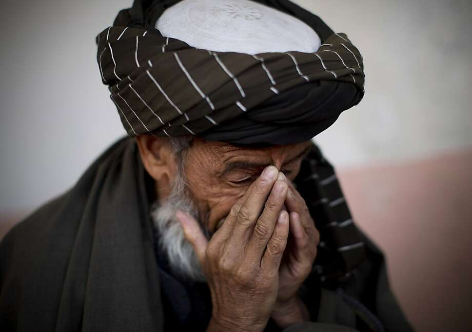 Hazratullah breaks down as he tells the story of his 21 year old son in U.S. Special Forces custody in Maidan Shahr, Wardak province, Afghanistan, Sunday, March 10, 2013. Afghan President Hamid Karzai, infuriated by villager reports of forced detentions and mass arrests, gave U.S. Special Forces two weeks to vacate Wardak province, located barely 30 kilometers (24 miles) from the Afghan capital of Kabul. The deadline for their withdrawal expired midnight Sunday, March 10, 2013.  Photo: Anja Niedringhaus, Associated Press
