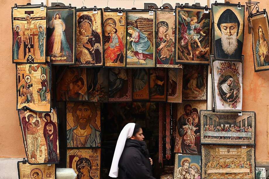A nun walks past a shop selling religious souvenirs on March 11, 2013 in Rome, Italy. Cardinals are set to enter the conclave to elect a successor to Pope Benedict XVI after he became the first pope in 600 years to resign from the role. The conclave is scheduled to start on March 12 inside the Sistine Chapel and will be attended by 115 cardinals as they vote to select the 266th Pope of the Catholic Church.  Photo: Dan Kitwood, Getty Images