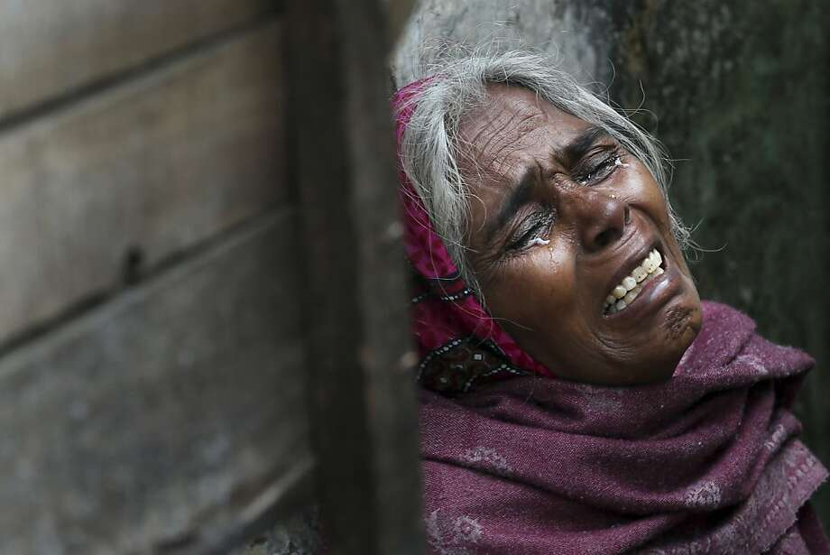 The mother of Ram Singh, the man accused of driving the bus on which a 23-year-old student was gang raped in December 2012, cries as she speaks to journalists outside the family's home in New Delhi, India, Monday, March 11, 2013. Indian police confirmed that Ram Singh, one of the men on trial for his alleged involvement in the gang rape and fatal beating of a woman aboard a New Delhi bus committed suicide in an Indian jail Monday, but his lawyer and family allege he was killed.  Photo: Manish Swarup, Associated Press