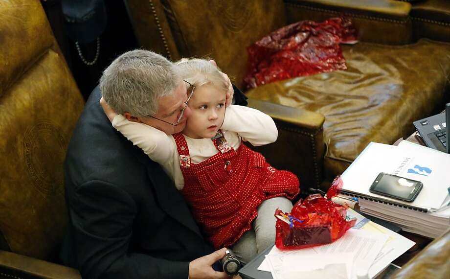 Grandpa, why won't that man shut up? Five-year-old Taryn Boyd complains to her grandfather, Mississippi Rep. Randy Boyd, about a loud speech given by Rep. Eugene Forrest Hamilton during floor debate at the Capitol in Jackson. Several lawmakers brought their grandchildren or children to the Capitol during the first day of spring break at most schools. Photo: Rogelio V. Solis, Associated Press