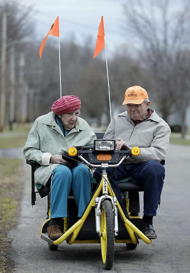 Keep it under 10 mph, Calvin. And no doughnuts:Calvin Raquet, 89, and wife Catherine, 90, scoot home after running some errands in town during the mild  weather in Akron, N.Y. Photo: David Duprey, Associated Press