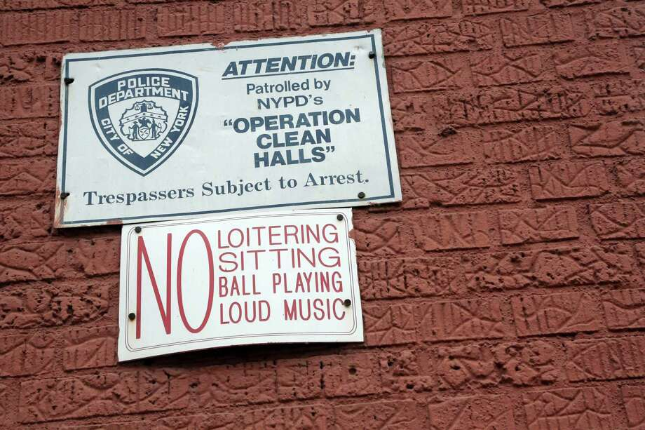 """In this Wednesday, March 6 2013 photo,  a sign is posted on the wall of a building in the Bronx borough of New York.   The building is one of thousands of private dwellings patrolled by the New York Police Department under a program known as """"Operation Clean Halls."""" (AP Photo/Mary Altaffer) Photo: Mary Altaffer"""