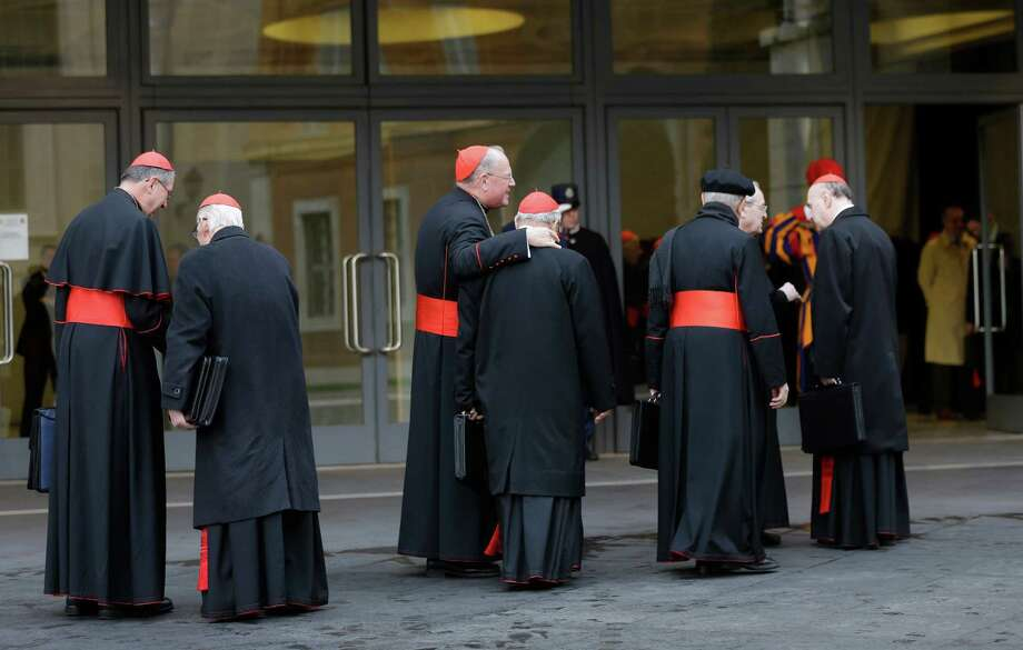 Cardinals, including U.S. Roger Mahony, left, and Timothy Dolan, third from left, arrive for a meeting at the Vatican, Monday March 11, 2013. Cardinals have gathered for their final day of talks before the conclave to elect the next pope amid debate over whether the Catholic Church needs a manager pope to clean up the Vatican's messy bureaucracy or a pastoral pope who can inspire the faithful and make Catholicism relevant again. (AP Photo/Alessandra Tarantino) Photo: Alessandra Tarantino