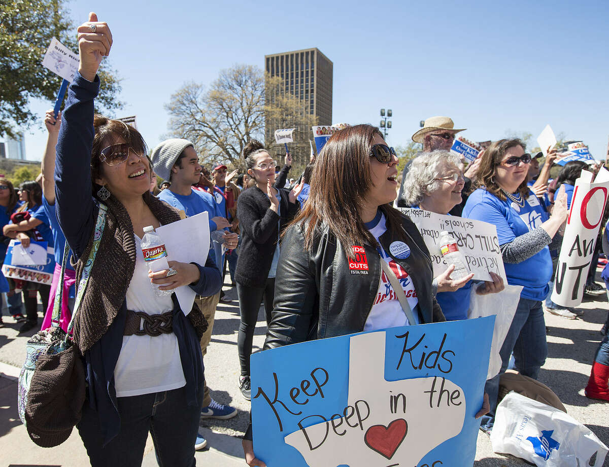 Educators Bonnie Reyes (left) and Iris Zepeda cheer at a rally for public education funding at the Texas Capitol.