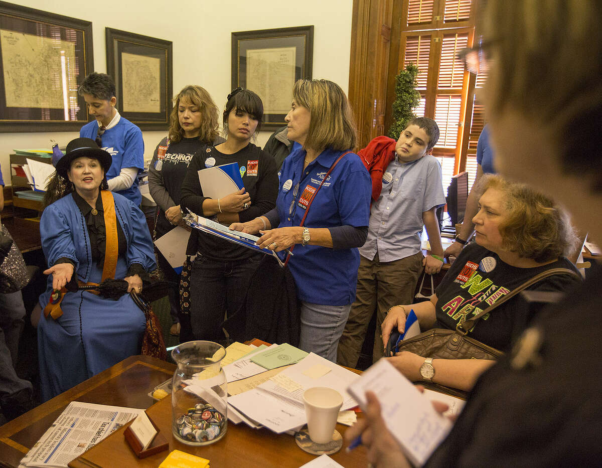 Educators discuss issues with Bonnie Bruce (right), chief of staff for state Sen. Donna Campbell, before the rally. Five busloads of San Antonio school employees attended the event, joining hundreds of colleagues from around the state.