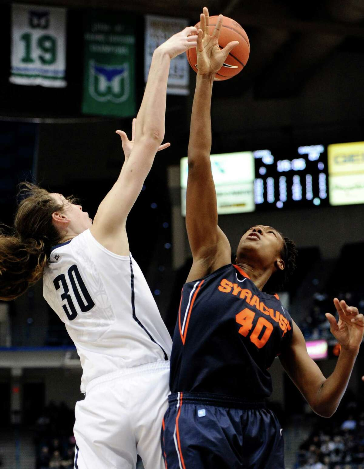 Connecticut's Breanna Stewart, left, and Syracuse's Kayla Alexander fight for a rebound in the second half of an NCAA college basketball game in the semifinals of the Big East Conference women's tournament in Hartford, Conn., Monday, March 11, 2013. (AP Photo/Jessica Hill)