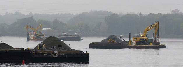 Barges with backhoes work in the Hudson River just below Lock 7 seen here during a boat tour along the Champlain Canal and the Hudson River to see the PCB dredging process taking place on Thursday, Sept. 22, 2011 near Fort Edward.  The tour was open to members of the media, members of the Community Advisory Group for the  Hudson River PCBs Superfund Site and other interested parties.  The State's Canal Corp provided the boat and the EPA gave the tour.  (Paul Buckowski / Times Union) Photo: Paul Buckowski / 00014598A