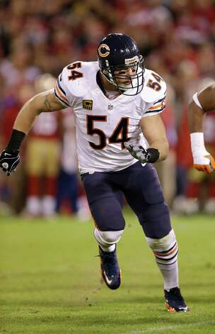 In this Monday, Nov. 19, 2012 photo, Chicago Bears middle linebacker Brian Urlacher (54) runs the field against the San Francisco 49ers during the second half of an NFL football game in San Francisco. Most of the big names hitting NFL free agency in 2013 aren't big stars anymore. While Ed Reed is coming off a Super Bowl season in Baltimore and Wes Welker catches 100 passes every year, this crop is more about aging defensive players such as Charles Woodson, Urlacher and Ronde Barber. (AP Photo/Marcio Jose Sanchez) Photo: Marcio Jose Sanchez