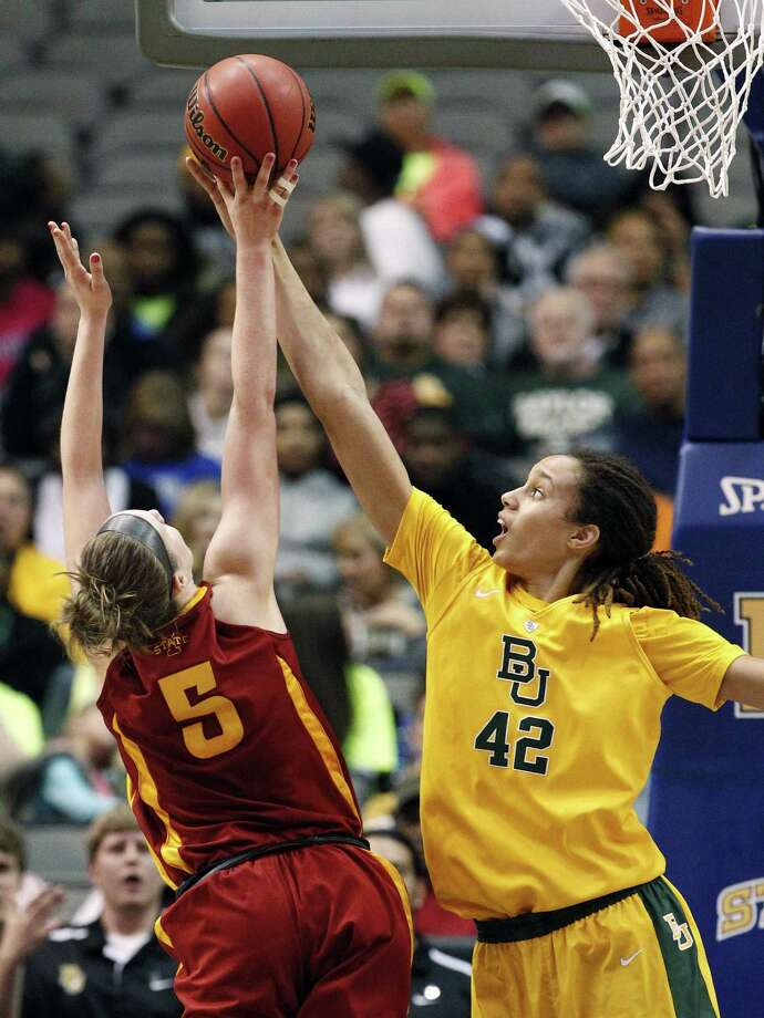 Brittney Griner gets one of her five blocks on Iowa State's Hallie Christofferson. Griner also had 31 points. Photo: Tony Gutierrez / Associated Press