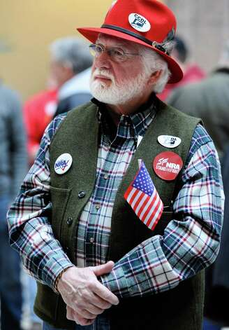 "Tom Smith of Cromwell, Conn., shows his support during a ""lobby day"" held by the National Rifle Association and other gun rights groups at the Legislative Office Building in Hartford, Conn., Monday, March 11, 2013. Both sides of the gun control issue are increasing pressure on Connecticut lawmakers who are close to voting on changes to state law stemming from the deadly shooting at Sandy Hook Elementary School in Newtown. Photo: Jessica Hill, Associated Press/Jessica Hill / Associated Press"