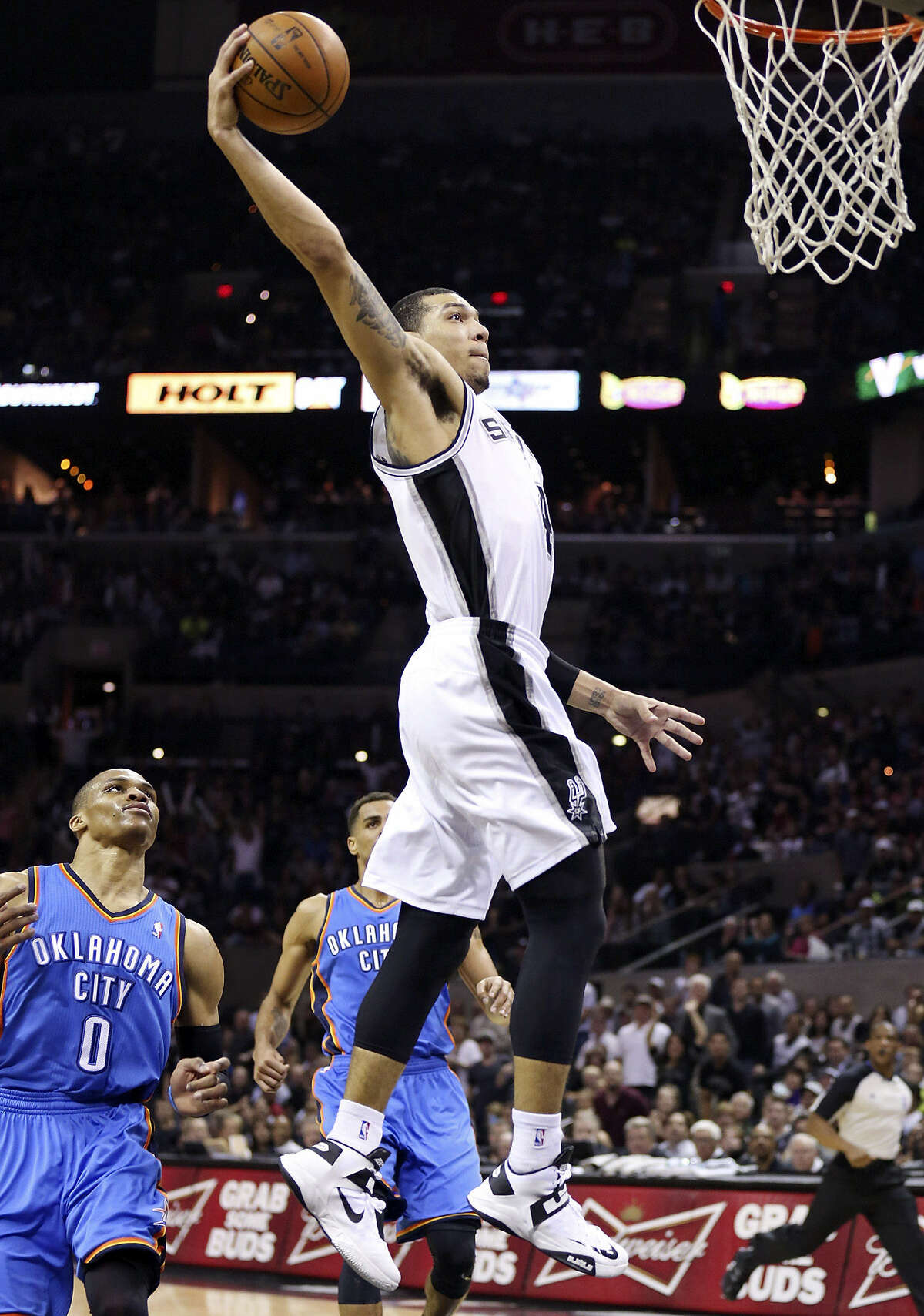 Spurs guard Danny Green, who had 16 points, leaves Thunder guard Russell Westbrook (0) behind as he goes up for a dunk.