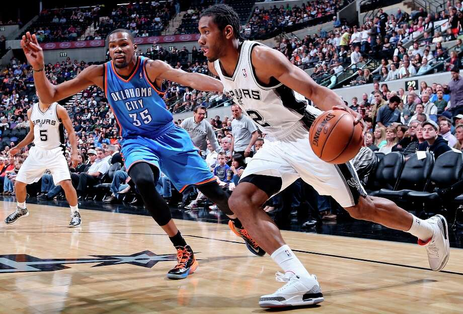 The Spurs' Kawhi Leonard looks for room around Oklahoma City Thunder's Kevin Durant during first half action Monday, March 11, 2013 at the AT&T Center. Photo: Edward A. Ornelas, San Antonio Express-News / © 2013 San Antonio Express-News