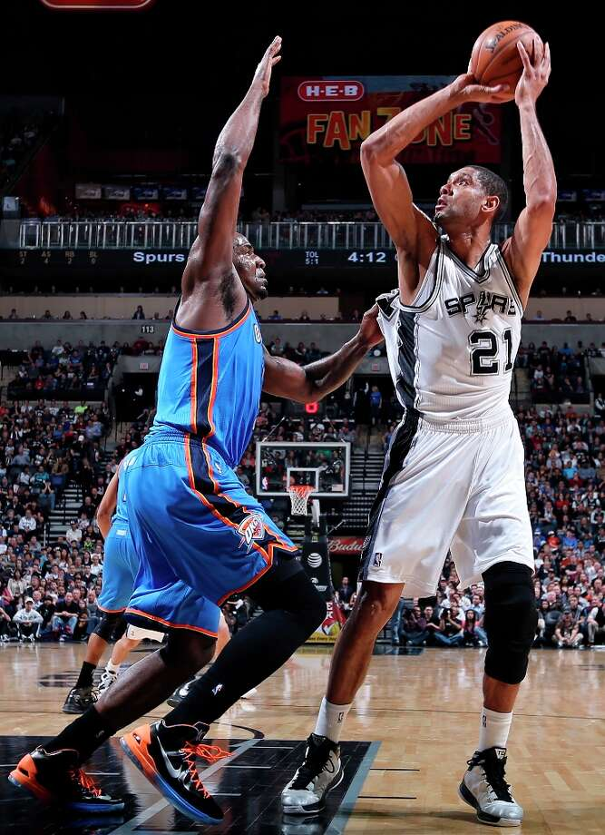 The Spurs' Tim Duncan shoots over Oklahoma City Thunder's Kendrick Perkins during first half action Monday, March 11, 2013 at the AT&T Center. Photo: Edward A. Ornelas, San Antonio Express-News / © 2013 San Antonio Express-News