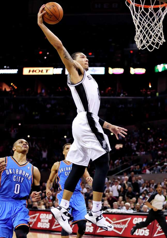 The Spurs' Danny Green goes up for a dunk around Oklahoma City Thunder's Russell Westbrook during second half action Monday, March 11, 2013 at the AT&T Center. The Spurs won 105-93. Photo: Edward A. Ornelas, San Antonio Express-News / © 2013 San Antonio Express-News