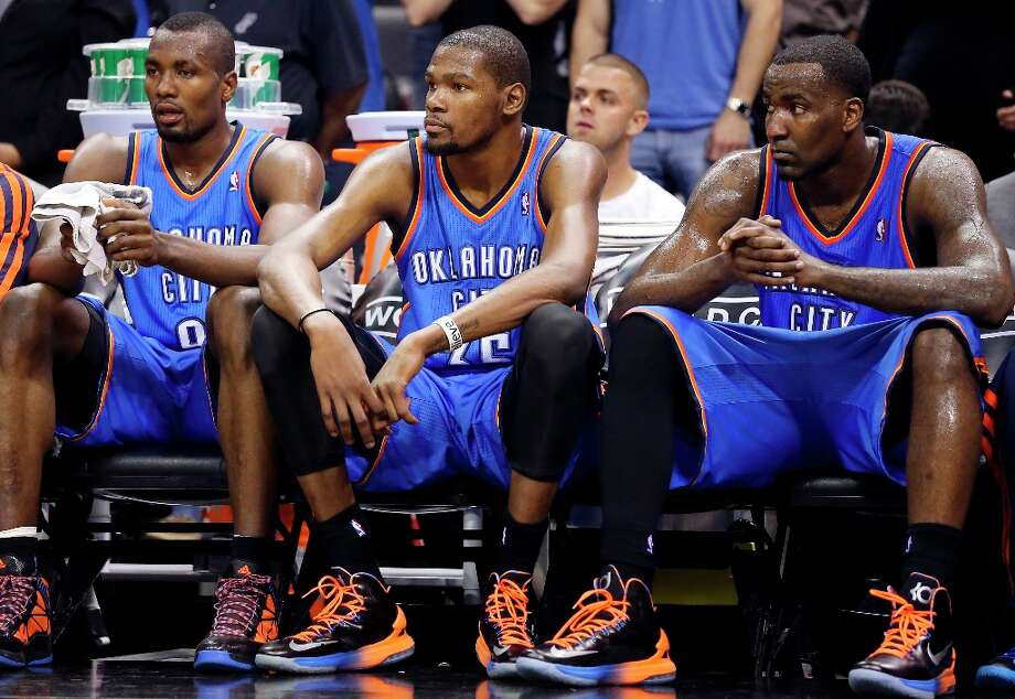 Oklahoma City Thunder's Serge Ibaka (from left), Kevin Durant, and Kendrick Perkins sit on the bench late in the game with the the Spurs on Monday, March 11, 2013 at the AT&T Center. The Spurs won 105-93. Photo: Edward A. Ornelas, San Antonio Express-News / © 2013 San Antonio Express-News