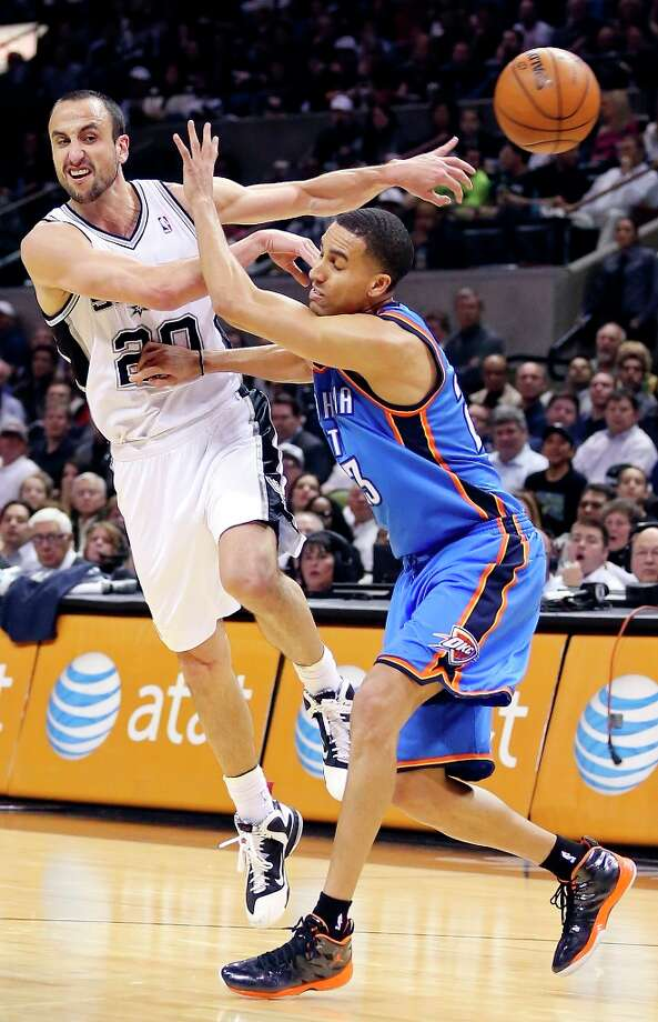 The Spurs' Manu Ginobili passes around Oklahoma City Thunder's Kevin Martin during second half action Monday, March 11, 2013 at the AT&T Center. The Spurs won 105-93. Photo: Edward A. Ornelas, San Antonio Express-News / © 2013 San Antonio Express-News