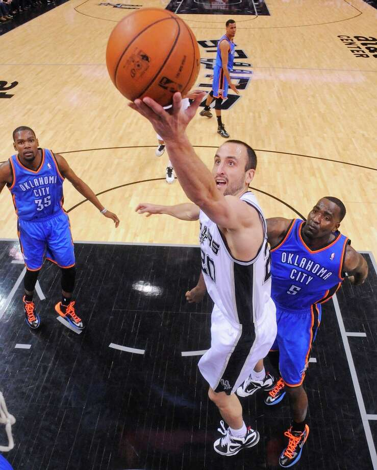 The Spurs' Manu Ginobili shoots around Oklahoma City Thunder's Kendrick Perkins as Oklahoma City Thunder's Kevin Durant (left) looks on during second half action Monday, March 11, 2013 at the AT&T Center. The Spurs won 105-93. Photo: Edward A. Ornelas, San Antonio Express-News / © 2013 San Antonio Express-News