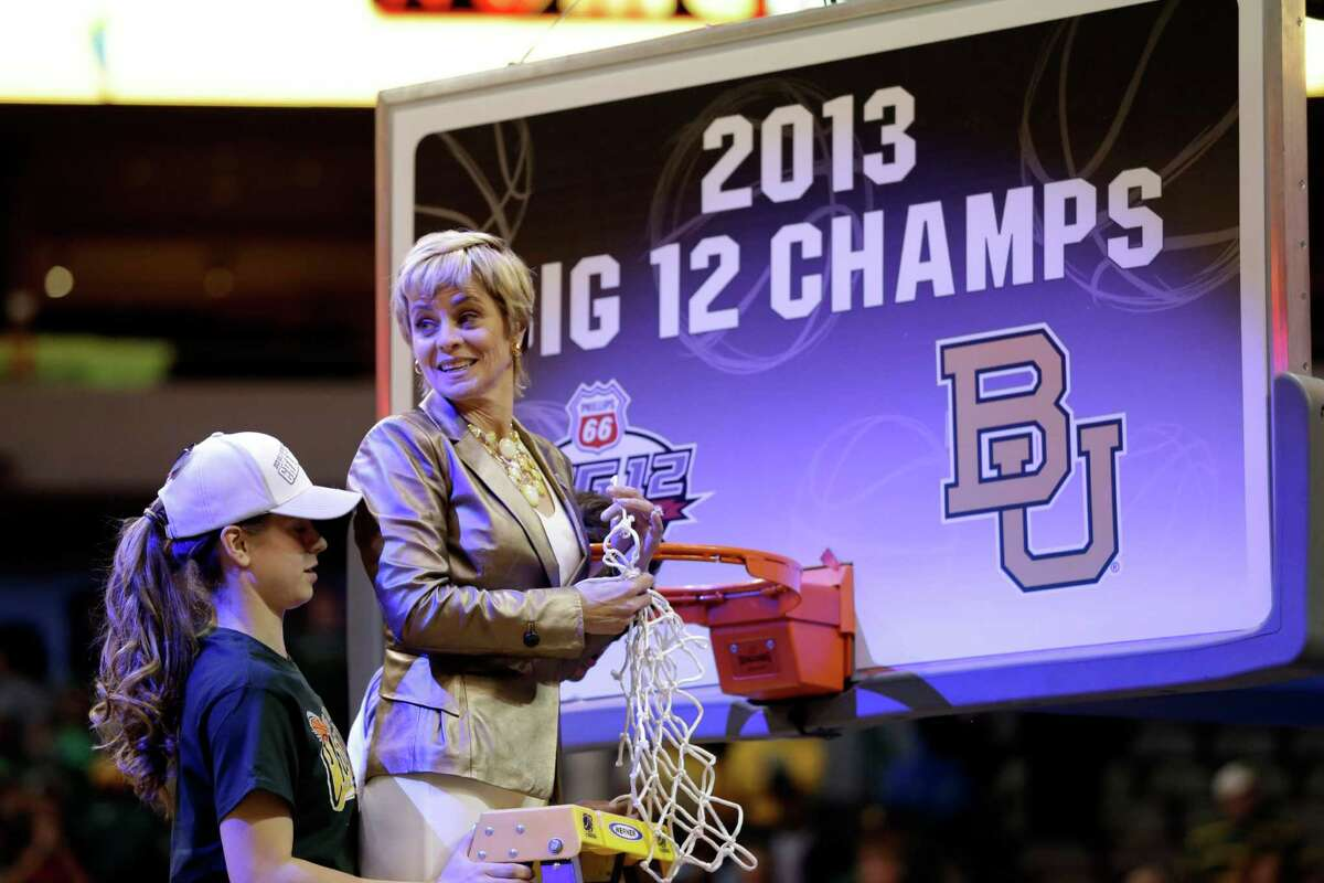 Baylor guard Makenzie Robertson, left, and her mother, head coach Kim Mulkey stand atop the latter after cutting down a link off the net following half of their NCAA college basketball championship game against Iowa State in the Big 12 Conference tournament, Monday, March 11, 2013, in Dallas. Baylor won 75-47. (AP Photo/Tony Gutierrez)