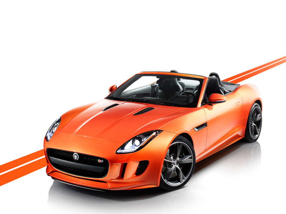 "2014 Jaguar F-TypeWhat Popular Mechanics said: ""It is certainly the most purposeful all-new sports car to come from Jag in quite some time.""Source: Popular Mechanics Photo: Jaguar"