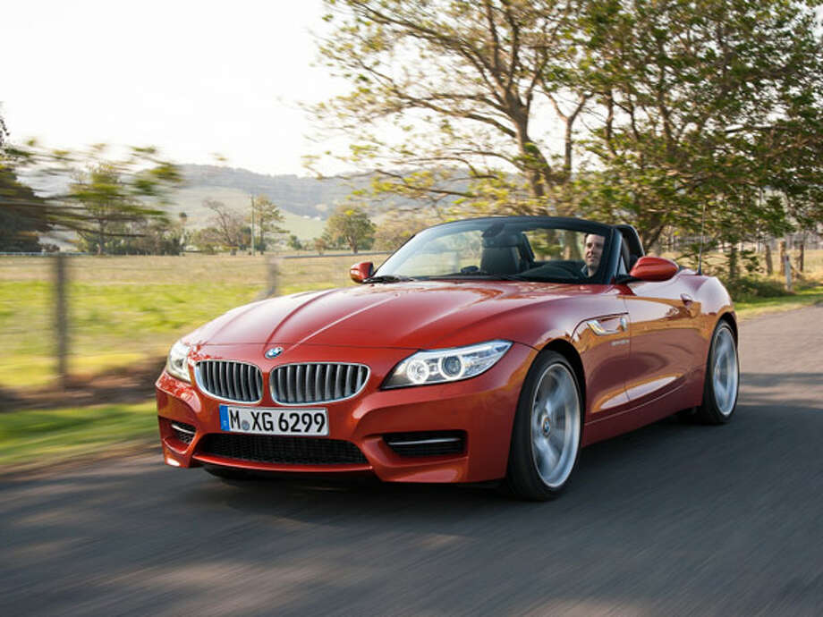 "2014 BMW Z4 sDrive35isWhat Popular Mechanics said: ""The Z4 gets a handful of minor upgrades for 2014, but thankfully the sweet twin-turbocharged 335-hp inline six remains in place, paired to a dual-clutch transmission. That means 60 mph will fly by in less than 5 seconds.""Source: Popular Mechanics Photo: Tom Kirkpatrick, BMW / This image is copyright free for editorial use. (c) BMW AG"