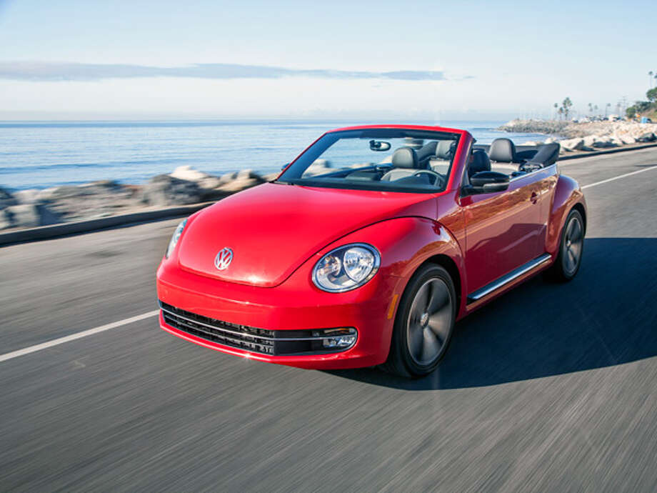 "2013 VW Beetle Turbo What Popular Mechanics said: ""This new Beetle convertible packs more visual heat than the old one. It's both muscled and finely tailored at the same time—the VW feels like it costs more than it actually does.""Source: Popular Mechanics Photo: Volkswagen"