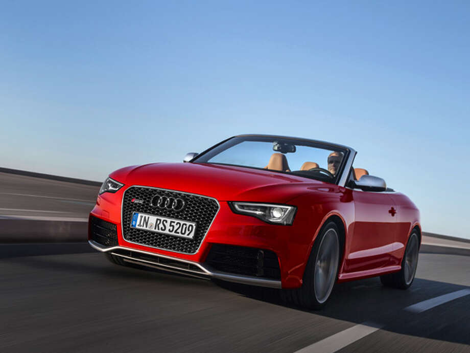 "2014 Audi RS5 Cabriolet  What Popular Mechanics said: ""The new Audi RS5 Cabrio is one of the quickest ways you can whisk away four people and all their stuff for a weekend of fun.""Source: Popular Mechanics Photo: Audi"
