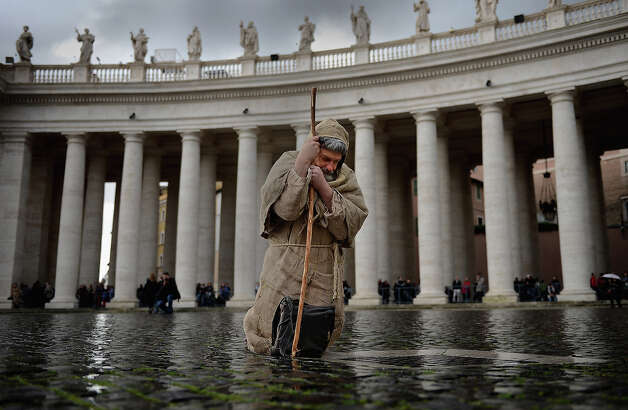 Pilgrims gather in St Peter's Square as cardinals attend mass before entering the conclave on March 12, 2013 in Vatican City, Vatican. Pope Benedict XVI?s successor is being chosen by the College of Cardinals in Conclave in the Sistine Chapel. The 115 cardinal-electors, meeting in strict secrecy, will need to reach a two-thirds-plus-one vote majority to elect the 266th Pontiff. Photo: Jeff J Mitchell, Getty Images / 2013 Getty Images