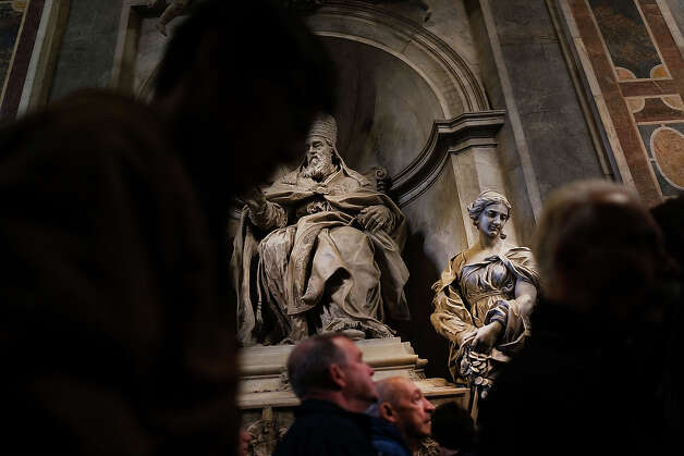 People attend the Pro Eligendo Romano Pontifice Mass at St Peter's Basilica, after  which Cardinals will enter the conclave to decide who the next pope will be on March 12, 2013 in Vatican City, Vatican. Cardinals are set to enter the conclave to elect a successor to Pope Benedict XVI after he became the first pope in 600 years to resign from the role. The conclave is scheduled to start on March 12 inside the Sistine Chapel and will be attended by 115 cardinals as they vote to select the 266th Pope of the Catholic Church. Photo: Spencer Platt, Getty Images / 2013 Getty Images