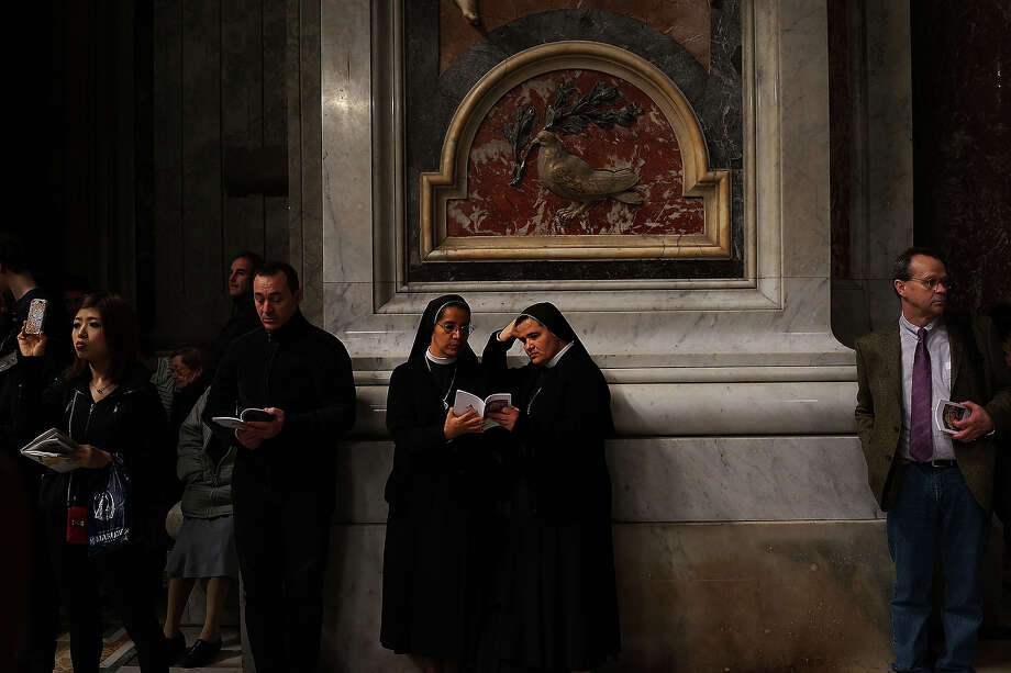 Two nuns attend the Pro Eligendo Romano Pontifice Mass at St Peter's Basilica, after  which Cardinals will enter the conclave to decide who the next pope will be on March 12, 2013 in Vatican City, Vatican. Cardinals are set to enter the conclave to elect a successor to Pope Benedict XVI after he became the first pope in 600 years to resign from the role. The conclave is scheduled to start on March 12 inside the Sistine Chapel and will be attended by 115 cardinals as they vote to select the 266th Pope of the Catholic Church. Photo: Spencer Platt, Getty Images / 2013 Getty Images